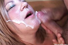 Blonde mature gives BJ And Takes Facial