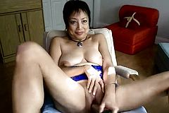 Horny Asian granny fucks herself With a dildo